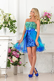 Beautiful woman in blue  dress in luxury interior.