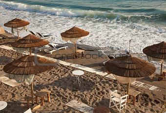 Beach with wooden umbrellas