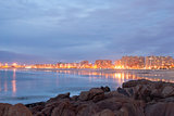 Long exposure of beach with city, Matosinhos, Portugal