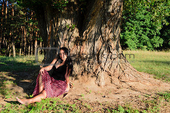 A girl under the tree