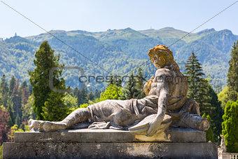 Antique woman statue on pedestal
