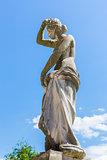 Draped woman statue