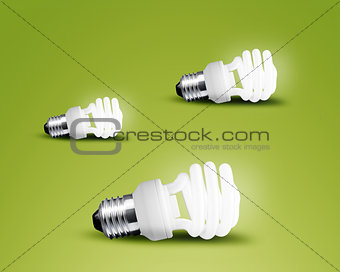 Three glowing Light bulb idea on green background