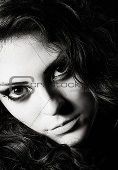 Closeup dramatic portrait of beautiful young girl. Black and white