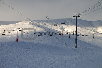 Ski slope with chair-lift in evening