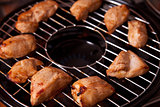 Grilled chicken meat on gas grill