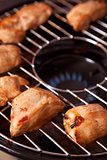 Chicken meat on gas grill