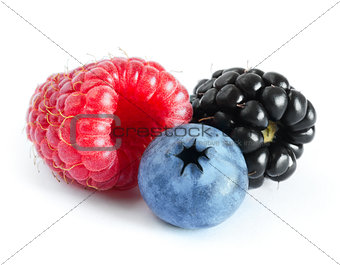 Ripe Sweet Raspberry, Blueberry and Blackberry on the White