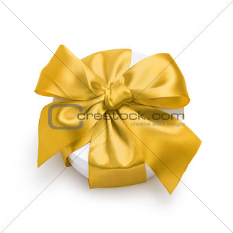 cylinder gift box with ornate ribbon bow