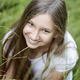 portrait of beautiful teen girl on the grass