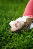 young attractive girl lying on the grass