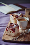 Raspberry cake and a cup of coffee