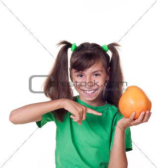 little girl with grapefruit