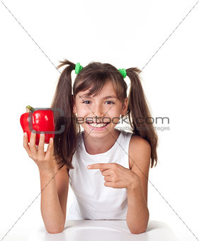 little girl with red pepper
