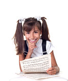 Cute little girl with books. School portrait.