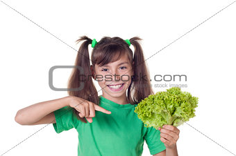 Little girl with lettuce