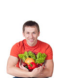 Young man with plate of fresh healthy vegetables