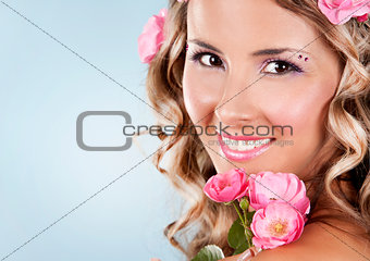 beautiful face with pink roses