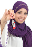 Close up of a beautiful arab woman holding a home keys