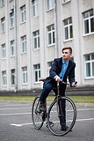 Young handsome man on a cycle