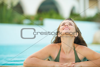 Portrait of happy young woman in pool