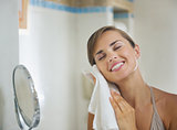 Happy young woman towel in bathroom