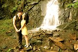 Romantic Retro Engaged Couple by Waterfall