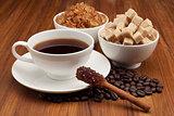 Cup of Coffee and Sugar Cinnamon Stick