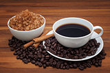 Coffee cup and beans on wood table