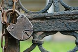 The old hinged lock on a chain