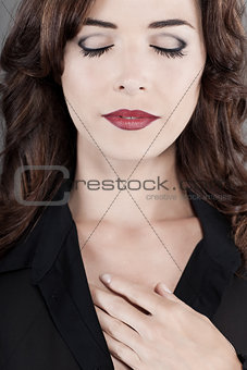 Sensuous woman with beautiful red lips and eyes closed