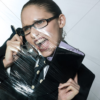 business woman under pressure on the telephone