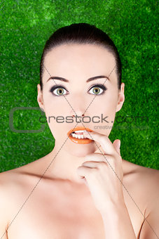 Beautiful nervous woman biting her finger