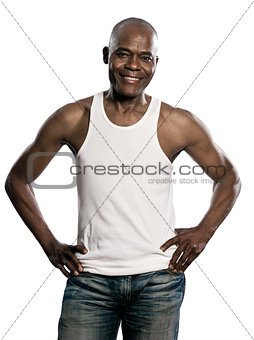 Portrait of handsome smiling african man with hands on waist