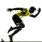 young man sprinter runner in starting blocks silhouette