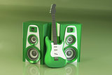 Guitar and louspeakers on green background