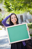 Excited Mixed Race Female Student Holding Blank Chalkboard