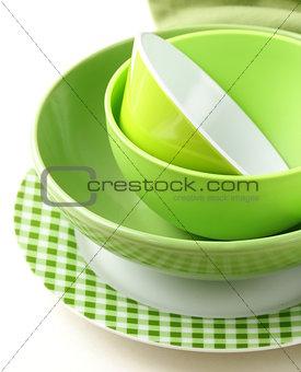stack green kitchen utensils  on a white background