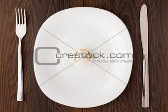 One ravioli on white plate