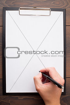 Clipboard with blank sheet of white paper and pen