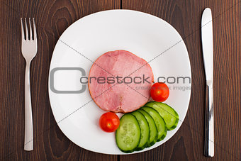 Slice of delicious ham on plate