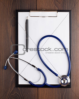 Clipboard with blank paper, pen and stethoscope