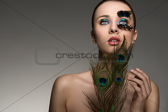 beauty portrait with colored feathers