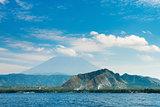 Big volcano rise over the island and sea