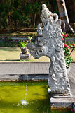 Fountain with traditional Balinese stone dragon statue