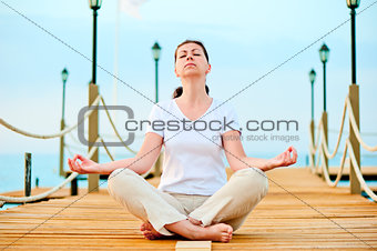 woman dressed in white doing yoga