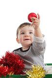 Pretty baby girl holding a christmas ball