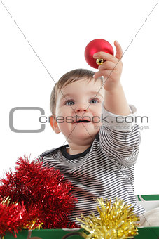 Pretty baby girl holding a christmas ball