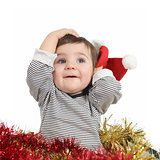 Pretty baby girl holding a santa claus hat