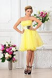 Beautiful woman in yellow dress in luxury studio.